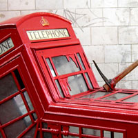 [Pickaxed red telephone booth]