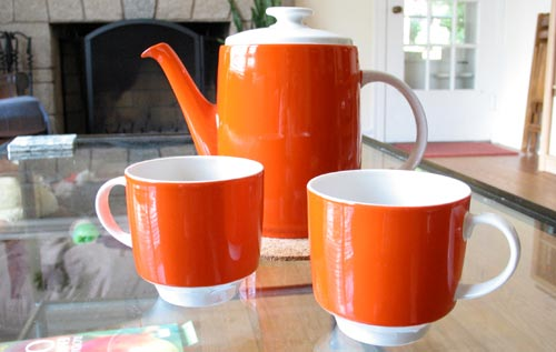 [red-orange coffee pot and cups]
