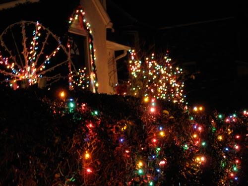 [more Christmas lights in the neighbourhood, nighttime]