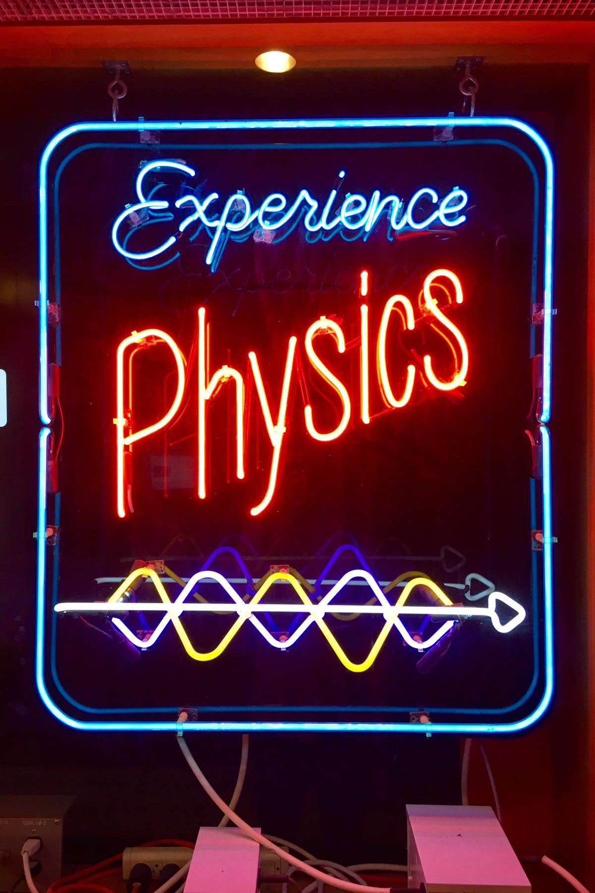 "[""Experience Physics"" blue and red neon sign]"